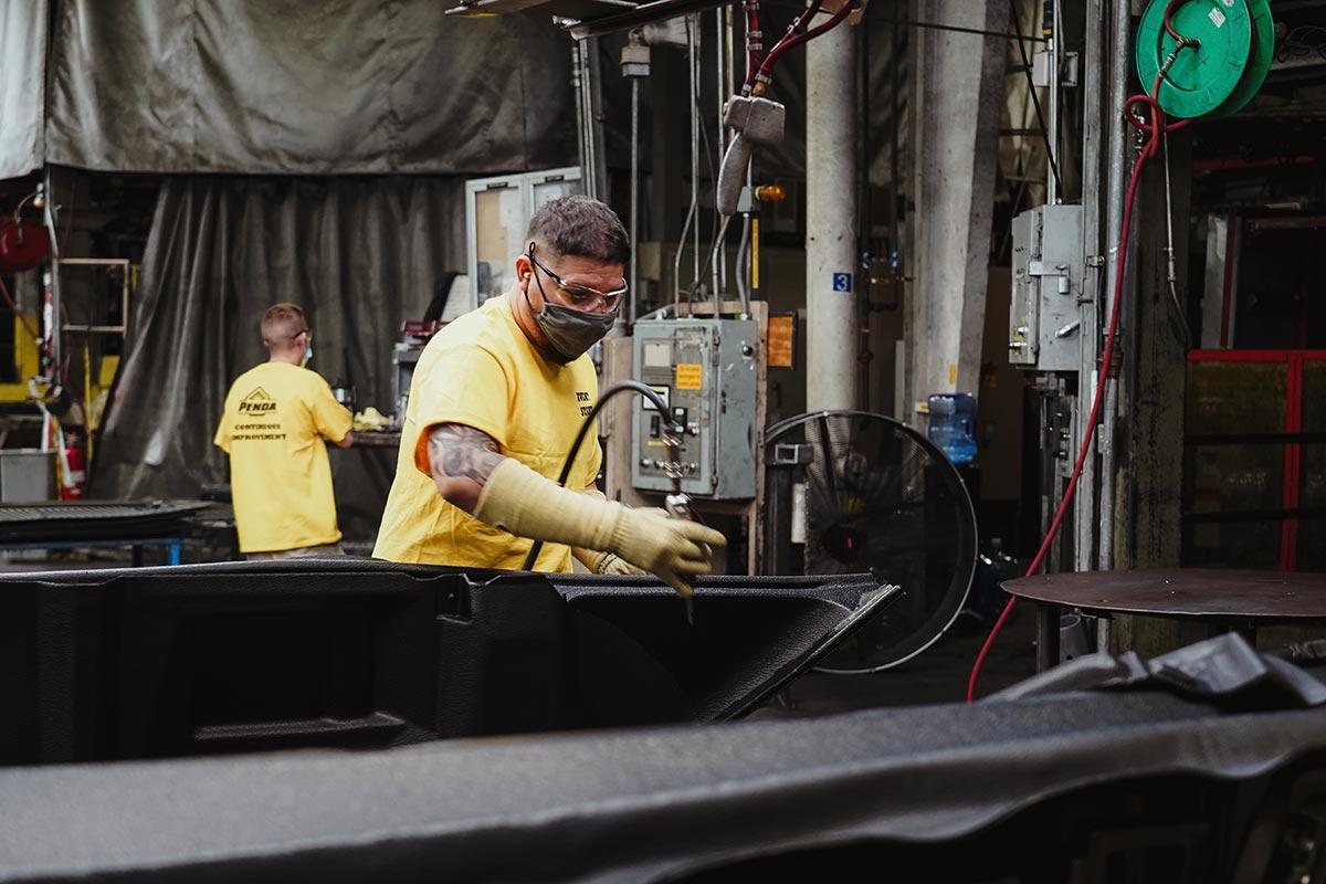 Penda employees finishing plastic products