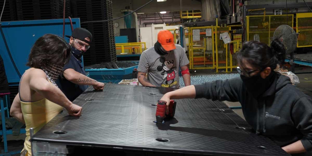 Penda employees working on plastic product